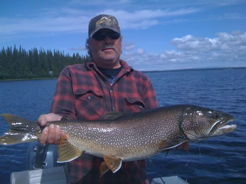 Kenai fishing guide's client holding Alaska Trout