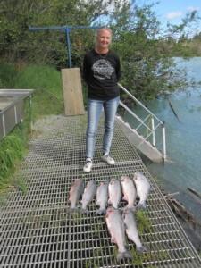 kenai-fishing-report-kasilof  A man standing on a dock with 8 king salmon