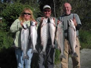kenai-fishing-report-kasilof - A woman and two men holding up six king salmon