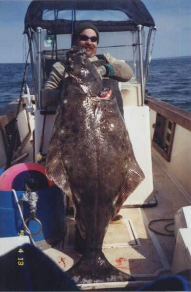 alaska-halibut-fishing - Man and a halibut