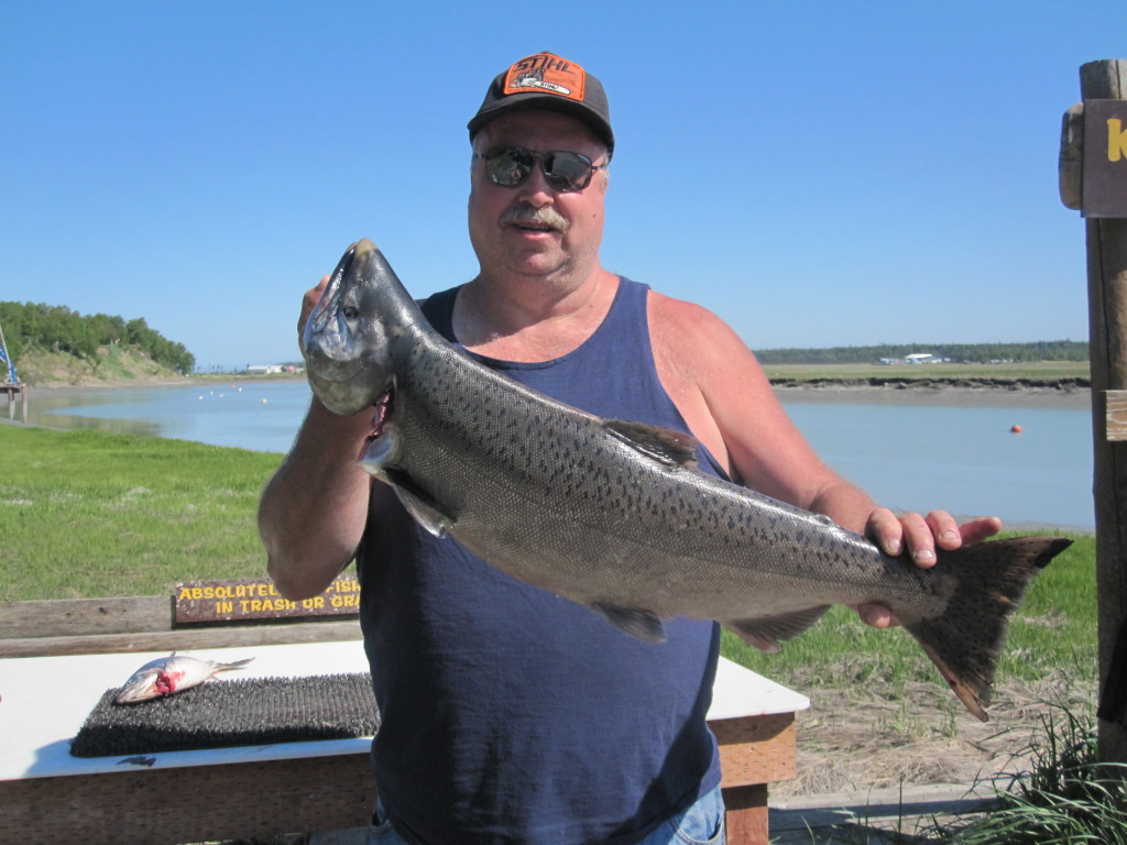 Fishing Report June 2013 Angler holding a large trout. In the background is the river