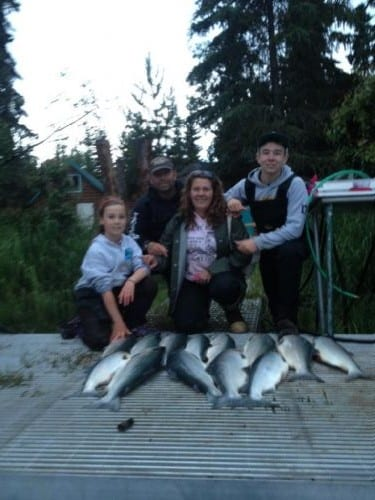 kenai fishing report 4 people with salmon catch