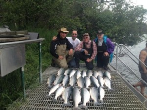 Angler clients of Kenai fishing guide Jim Rusk with a bunch of sockeye salmon laid out on the deck.