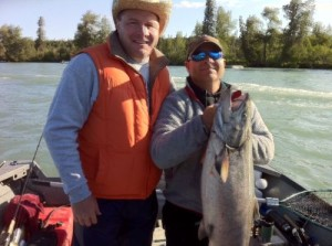 kenai-fishing-report-kasilof Two men, one holding a king salmon