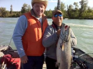 kenai-fishing-report-kasilof Two men, one holding a king salmon