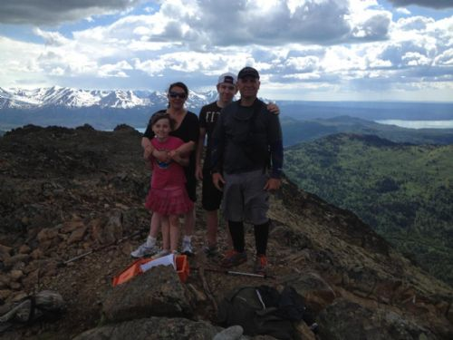 kenai-fishing-report-kasilof/ Two adults and two children standing on a mountain top
