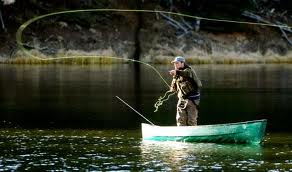 Alaska fly fishing in a boat